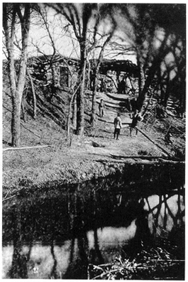 Photo of log house overlooking the Little Blue River, c. 1873.