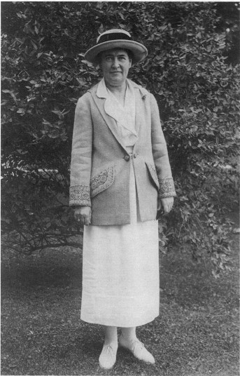 Full-length portrait of Willa Cather in July 1922 at Breadloaf in Vermont.