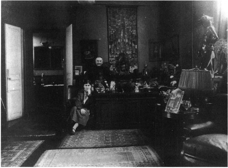 Photograph of Cather seated in front of Leon Bakst, both facing the camera in Bakst's studio in the summer of 1923.