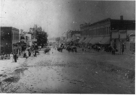 Photograph of Webster Street in Red Cloud taken before 1900, with people and carriages crowding the street.
