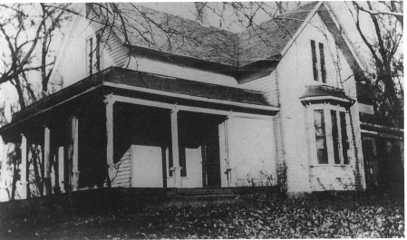 Photograph of the Garber house from the front, with the large porch in view and the bay window.