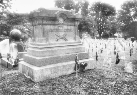This photograph was taken in Stonewall Confederate Cemetery, Winchester, Virginia, on June 7, 2001, the day after the observance of Confederate Memorial Day, which is celebrated in Winchester on June 6, the anniversary of General Turner Ashby's death in battle in 1862. As Cather mentions in the epilogue to Sapphira and the Slave Girl, Ashby's large tomb (inscribed THE BROTHERS ASHBY) is decorated with flowers, and all the graves in the cemetery are decorated with small Confederate flags. One of the small adjacent tombstones marks the grave of Willa Cather's uncle, James William Boak.