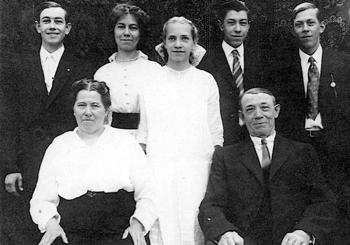 Image of The Landwehrkamps, Back row: (l-r) Heine, Minnie (grandmother), Fritz, and John. Center: Grace (great-aunt)Front: (l-r) Katherine and Henry (great-grandparents)