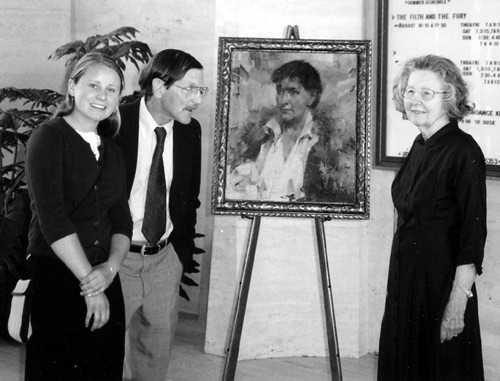 Image of From left: Mary Southwick (Mrs. Southwick's granddaughter), Jim Southwick (Mrs. Southwick's son), and Mrs. Southwicksurround the portrait of their distinguished relative during a reception at Sheldon.
