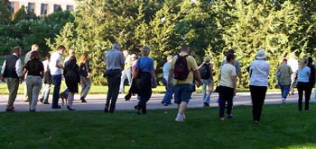 Image of Colloquium members walking across the UNL campus