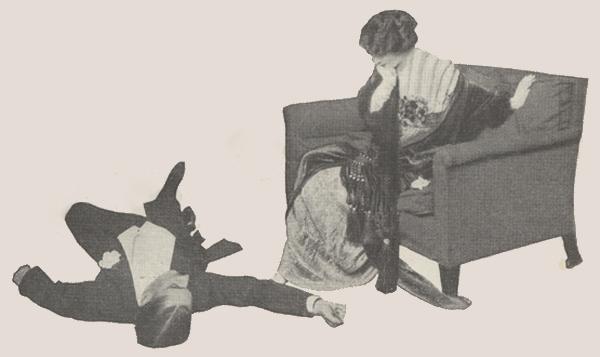 Jane Cowl looking with surprise at man lying on the floor.