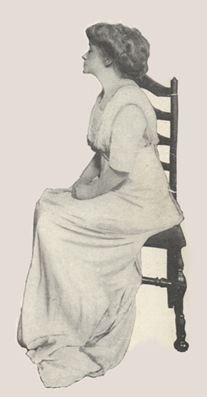 Profile of Mrs. Fiske sitting in a chair, head raised and eyes closed.