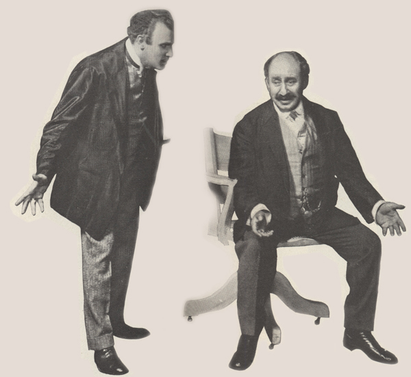 Carr as Perlmutter, standing and looking slightly downward; Barnard as Potash, seated with arms extended.